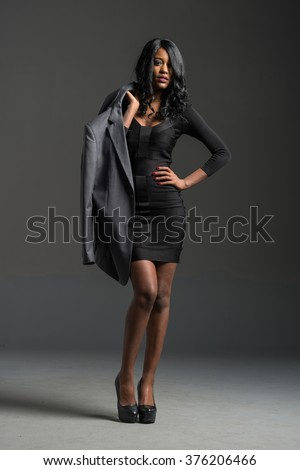black fashion model wearing stylish wardrobe clothes and accessories