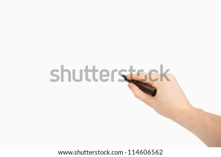 Black felt pen being held against a white background