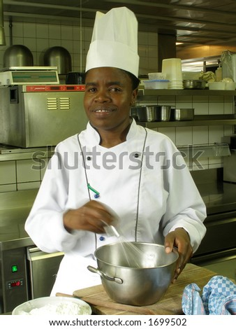 Black female chef is whisking the batter