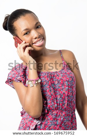 Black Female talking while smiling on her phone - stock photo