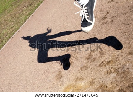 black figure silhouette of human shadow in flying jump - stock photo