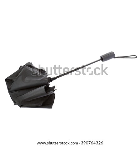 Black folded umbrella isolated over the white background - stock photo