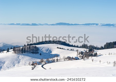 Black Forest in the winter with Vosges in the background - stock photo