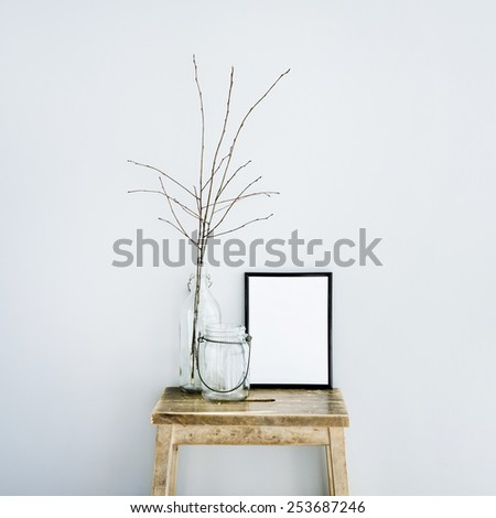 black frame with place for text  with glass bottles. Scandinavian hipster style room interior - stock photo