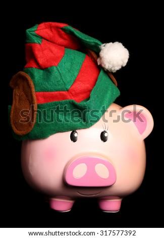 Black friday christmas elf piggy bank cutout - stock photo