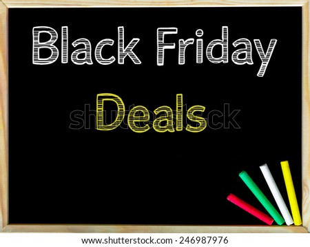 Black Friday Deals, vintage chalk text on blackboard, colored chalk in the corner, Retail Sale conceptual image  - stock photo