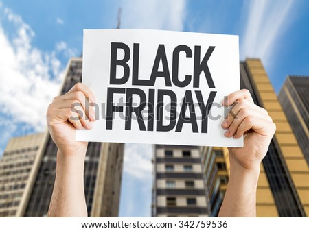 Black Friday placard with urban background - stock photo