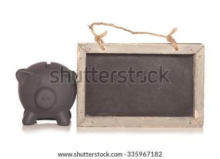 Black friday savings piggy bank and blackboard cutout - stock photo