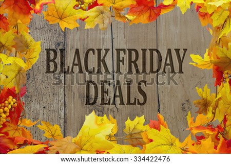 Black Friday Shopping Deals, Autumn Leaves with grunge wood with text Black Friday Deals - stock photo