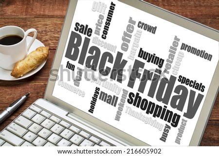 Black Friday shopping word cloud on a laptop computer with a cup of coffee - stock photo
