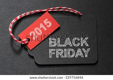 Black Friday 2015 text on a black tag with a red and white twine - stock photo