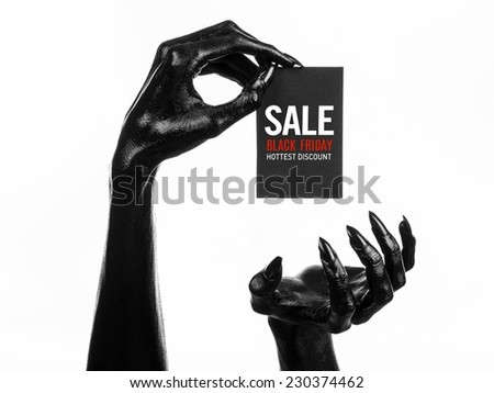 Black Friday theme: black hand holding a card with discount on white background - stock photo