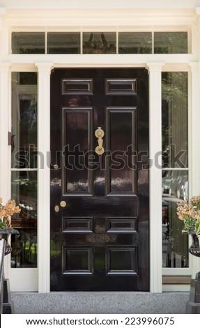 Black Front Door With White Door Frame And Windows