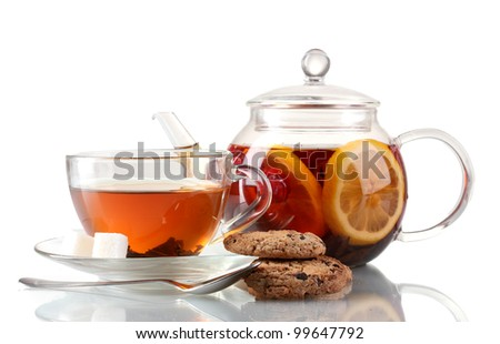 Black fruit tea in glass teaopot and cup isolated on white