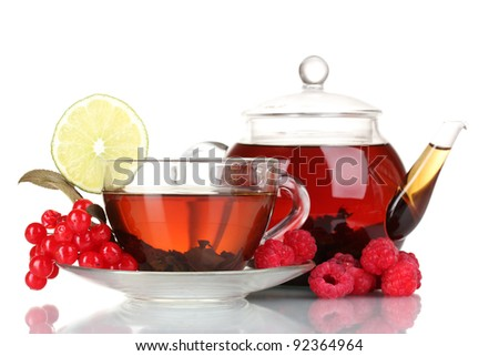 Black fruit tea in glass teapot and cup isolated on white - stock photo