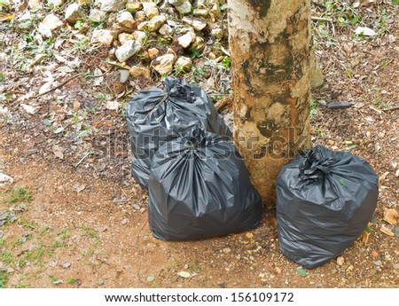 Black garbage bags for cleanup in the park - stock photo