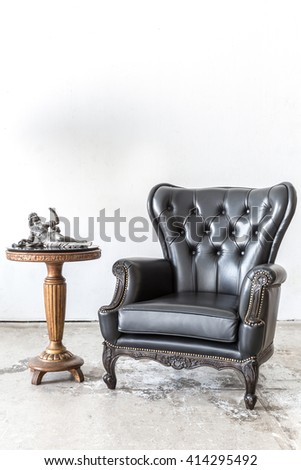 Black genuine leather classical style chair with side cabinet - stock photo
