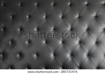 black genuine leather sofa pattern as background image - stock photo