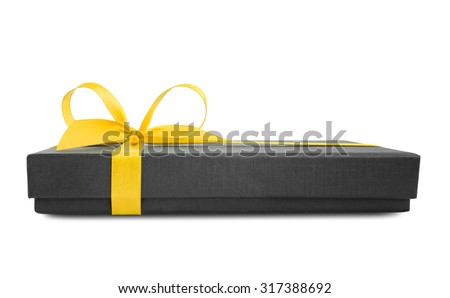 Black gift box (present) with yellow satin ribbon bow, side view, isolated on white background