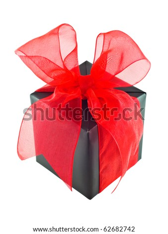 Black gift wrapped present with red organza ribbon bow isolated on white - stock photo