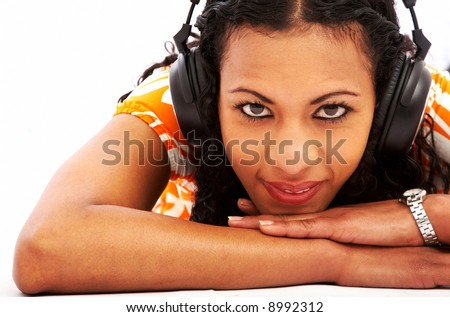 black girl listening to music looking happy over white - stock photo