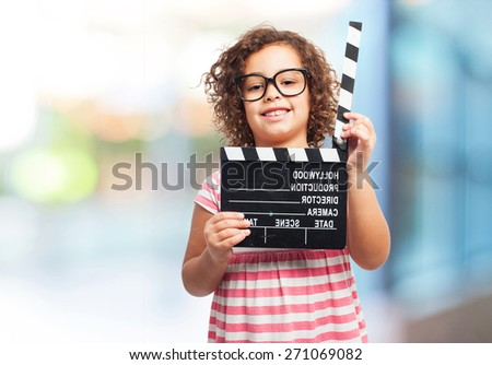 black girl with a clapperboard - stock photo