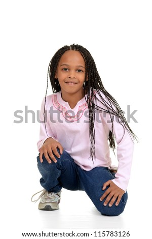 Black girl with corn rows sitting - stock photo