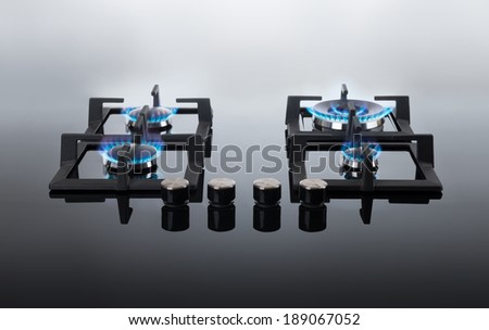 Black glass gas hob - stock photo