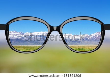 black glasses looking to nature