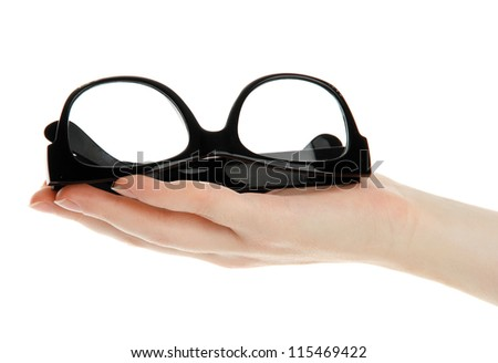black glasses on woman hand, isolated on white - stock photo