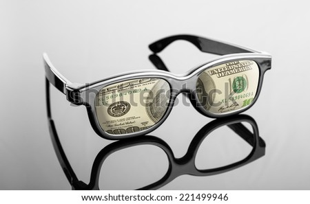 Black glasses with dollars instead of lenses - stock photo