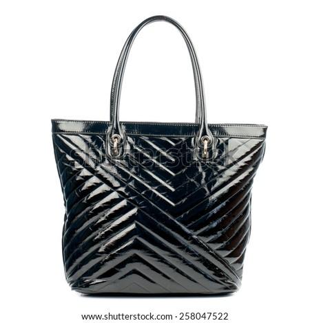Black glossy female handbag isolated on white background. - stock photo