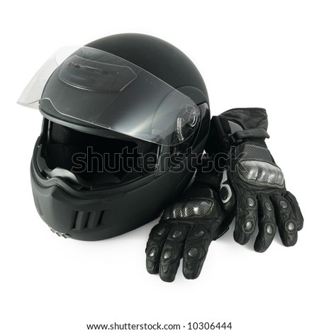 Black, glossy motorcycle helmet and leather gloves with carbon fiber protection - stock photo