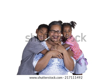 Black grandmother and grandchildren together smiling isolated on white