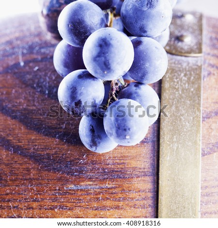 Black grape over small wooden barrel, horizontal image - stock photo
