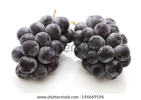 Black Grapes on white background - stock photo