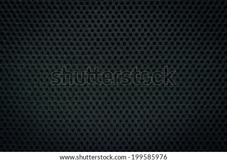 black gray fishnet cloth material as a texture background - stock photo