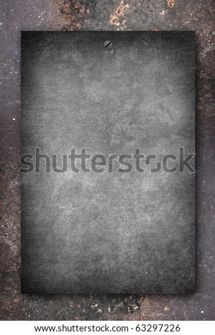 black grunge paper on dirty metal background