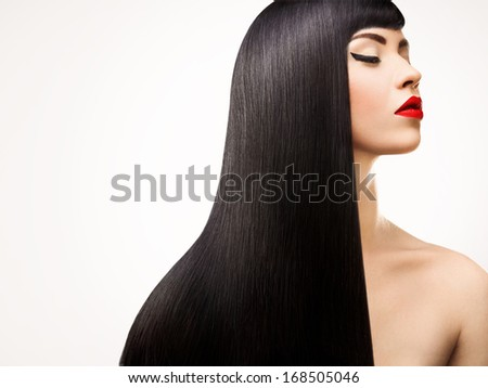Black Hair. Beautiful Brunette Girl with Healthy Long Hair. Red Lips and nice Makeup. - stock photo