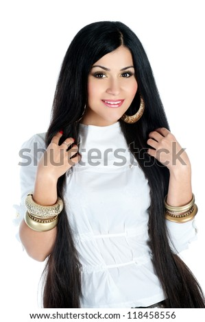 Black hair , beautiful brunette woman with long natural hairand gold earrings and bracelets - stock photo