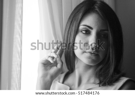 black hair Model girl near window