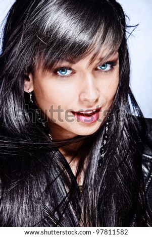black hair young woman with beautiful big blue eyes portrait - stock photo