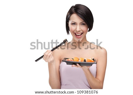 Black haired woman eating sushi with a chopsticks isolated stock