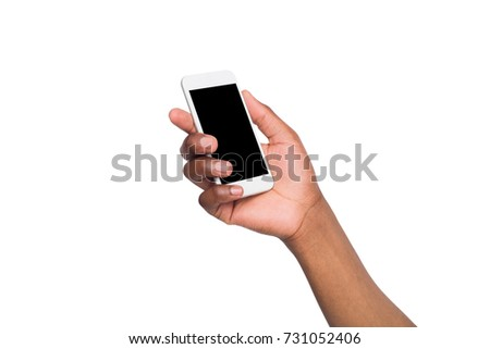 Black hand holding mobile phone on isolated white background. Copy space on screen