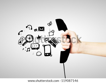 black handset in hand with social media icon - stock photo