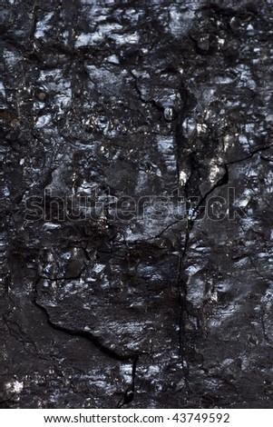 Black hard bituminous coal, carbon nugget background - stock photo