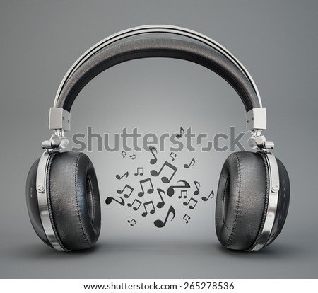 black headphones isolated on a greay background - stock photo