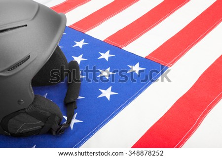 Black helmet over US flag as symbol of active life style