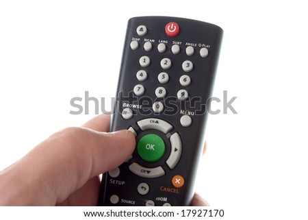Black Infrared remote control in hand on a white background