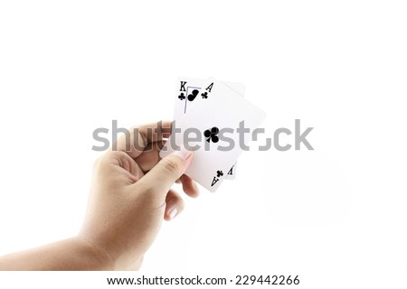 Black Jack two card of clubs in playing cards game in the hand on a white background ,focused on cards